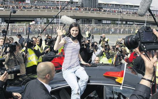 Lena Mayer-Landrut is greeted by thousands of fans at Hannover Airport in Germany yesterday after winning the Eurovision Song Contest in Oslo, Norway, on Saturday night.