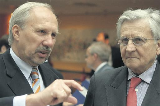 Austrian National Bank Governor Ewald Nowotny (left) talks with European Central Bank (ECB) President Jean-Claude Trichet before a conference hosted by Austrian National Bank in Vienna yesterday