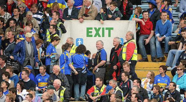 Tipperary supporters head for the exits in Pairc Ui Chaoimh before the end of their team's defeat to Cork last Sunday. RAY MCMANUS/SPORTSFILE