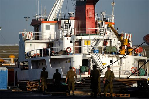 Israeli soldiers guarding one of the Gaza-bound ships held at the port of Ashdod, Israel, yesterday