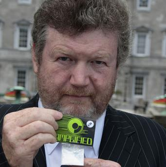 Dr James Reilly with a packet of 'Amplified'. TOM BURKE