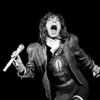 Mick Jagger of the Rolling Stones performs at an all-day concert at Knebworth Park in 1976
