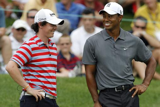 Tiger Woods and Rory McIlroy take a break on the 11th green during the Memorial Skins Game in Dublin, Ohio yesterday. Photo: Reuters