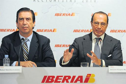 Antonio Vazquez, chief executive officer of Iberia, right, speaks as Rafael Sanchez- Lozano, the company's managing director and chief operating officer, listens during the company's annual shareholders' meeting in Madrid, yesterday