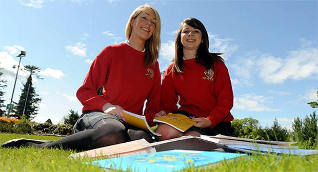 Emma Gleeson, left, and Fiona Comer never missed a day during their 14 years in the education system. Photo: Ray Ryan