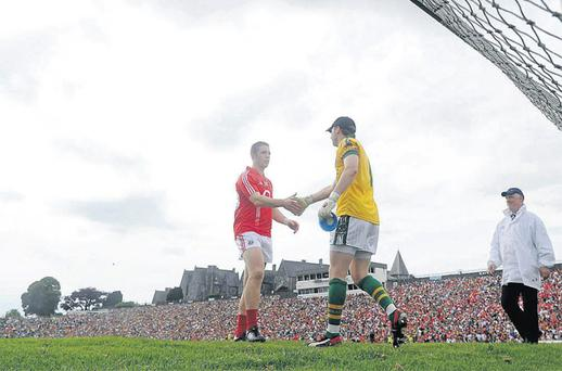 Cork's Colm O'Neill and Kerry goalkeeper Brendan Kealy shake hands after the final whistle of their Munster SFC semi-final in Fitzgerald Stadium, Killarney yesterday. Photo: Brendan Moran / Sportsfile