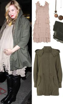Cutout ruffle dress Awear €40; Green parka from Warehouse €85; Topshop over the knee boots €122; Topshop black bag €79; Doolally.com necklace €27.