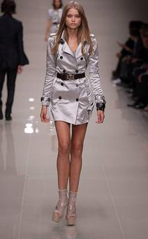 A model wears a grey satin Burberry trench coat at the Spring/Summer 2010 show - London Fashion Week. Photo: Getty Images