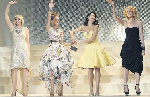'Sex and the City ' stars, from left, Kim Cattrall, Sarah Jessica Parker, Kristin Davis and Cynthia Nixon, wave upon arrival for the premiere of the film in Tokyo. Photo: AP