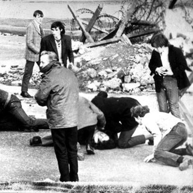 A man receiving attention during the shooting incident in Derry, which became known as Bloody Sunday