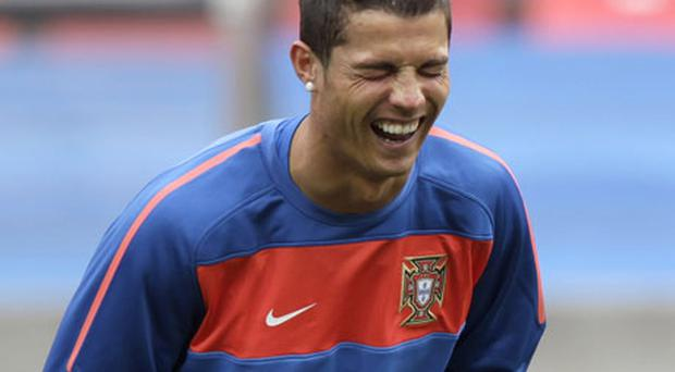 While the Portugal camp are eager to emphasise the spirit amongst their team, their hopes and dreams are likely to rest on the well-being of one man: Cristiano Ronaldo. Photo: Reuters