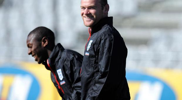 England's Wayne Rooney smiles during the training session at the Royal Bafokeng Sports Complex, Rustenberg, South Africa. Photo: PA