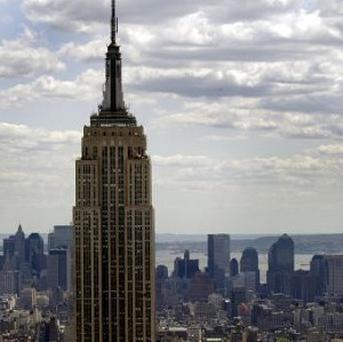 A skyscaper who tried to parachute off New York's Empire State Building has been banned from entering the building