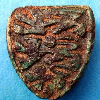 An archaeologist has discovered a medieval badge emblazoned with three lions