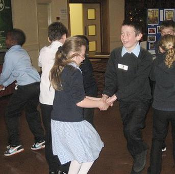 A parent has been banned from flying a child to a school ceilidh