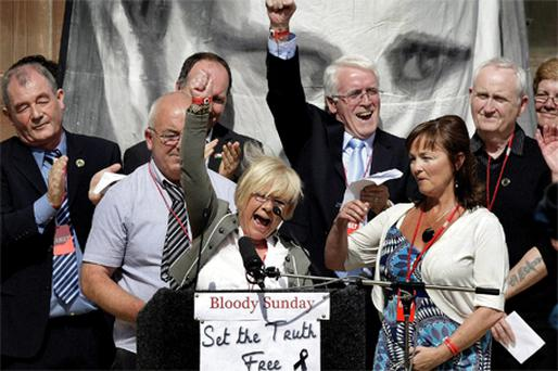 Family members of Bloody Sunday victims and Alana Burke (centre) celebrate on the steps of the Guildhall in Derry on Tuesday after the Saville Report cleared the dead and injured of any wrongdoing