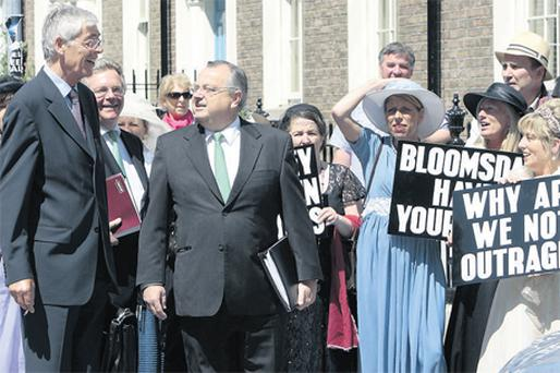 Anglo Irish Bank chairman Alan Dukes, chief financial officer Maarten Van Eden, and group chief executive Mike Anysley have a quick word with members of the St Michael's Estate, who were protesting over the banking crisis as the Anglo chiefs arrived to the Joint Committee on Finance and the Public Service meeting. Photo: Tom Burke