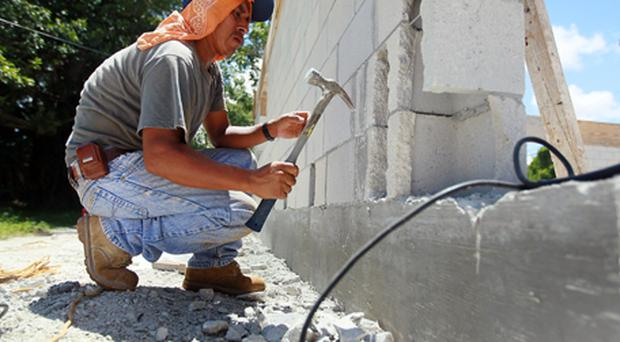A construction labourer works on a home on June 16 in Miami. Photo: Getty Images
