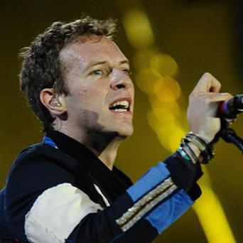 Coldplay have agreed to have their songs on hit show Glee