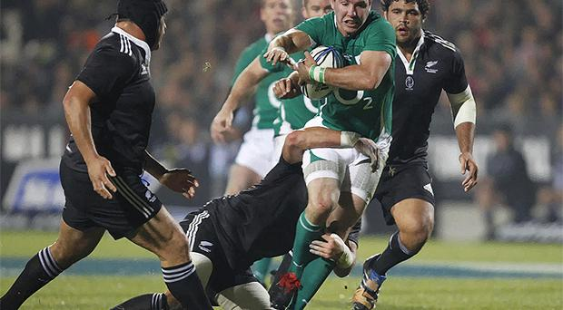 Paddy Wallace is tackled by New Zealand Maori's Colin Bourke. Photo: AP