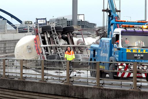 The overturned truck at the Red Cow Interchange on the Naas Road, Dublin, yesterday