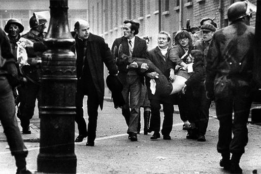 Fr Edward Daly who would later become Bishop of Derry, helps evacuate one the Bloody Sunday victims