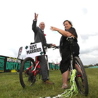 Honeymoon bride Alison Moore has settled for tent so hubby Nigel Moore can cycle