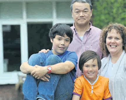 Siobhan O'Carroll, with her husband Yoshio Miyachi and sons Ronan and Sean.