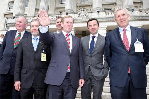 Fine Gael leader Enda Kenny, centre, with Seymour Crawford, Sean Kelly, Joe McHugh, Brian Hayes and Fergus O'Dowd at Stormont yesterday