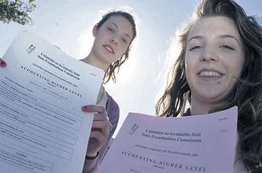 Laura Kinsman (left), from Glenageary, with the replacement paper, and Ali Foley, from Blackrock, with the original accountancy higher-level paper which was missing questions, pictured at St Andrew's College, Booterstown, Dublin