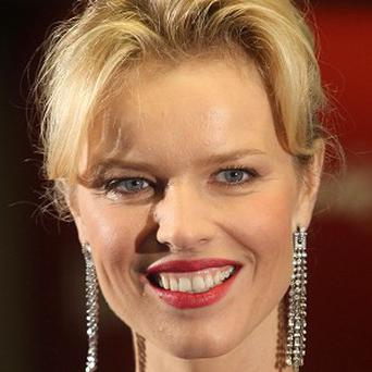 Eva Herzigova at Harrods in London to open the store's Summer sale