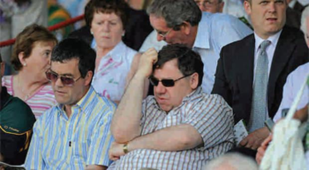 Those who wonder why we don't get as angry as the Greeks have obviously never been at a GAA match - Minister for Transport Noel Dempsey with Taoiseach Brian Cowen after Meath's defeat of Offaly in May
