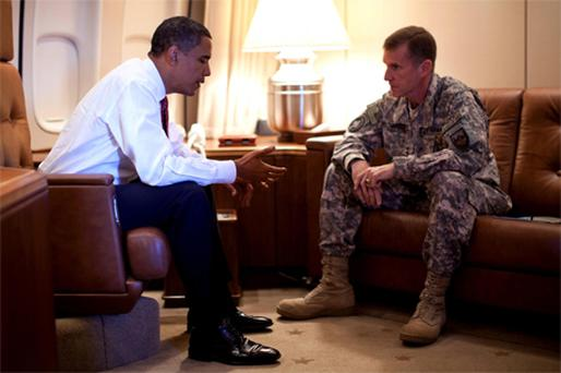 US President Barack Obama meeting with General Stanley McChrystal aboard Air Force One last year