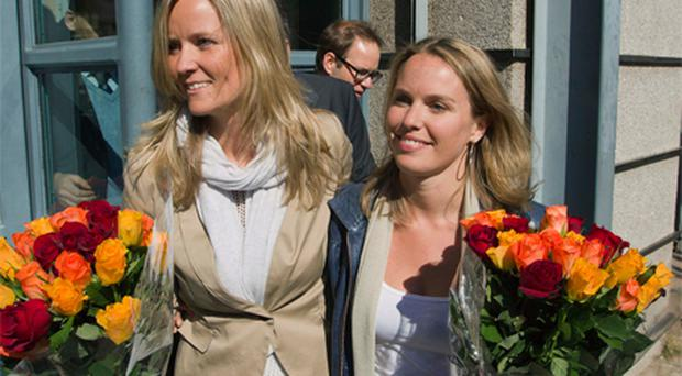 Barbara Castelein, left, and Mirthe Nieuwpoort celebrate their acquittal as they leave the court in Johannesburg yesterday