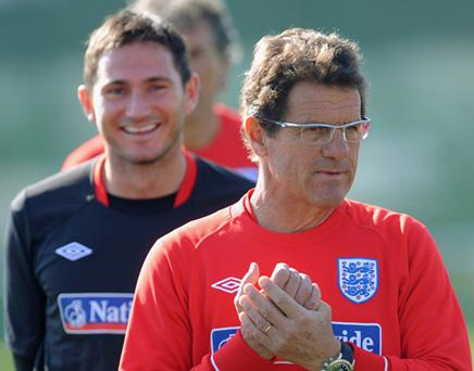 Frank Lampard smiles as England manager Fabio Capello looks on during England training. Photo: Getty Images