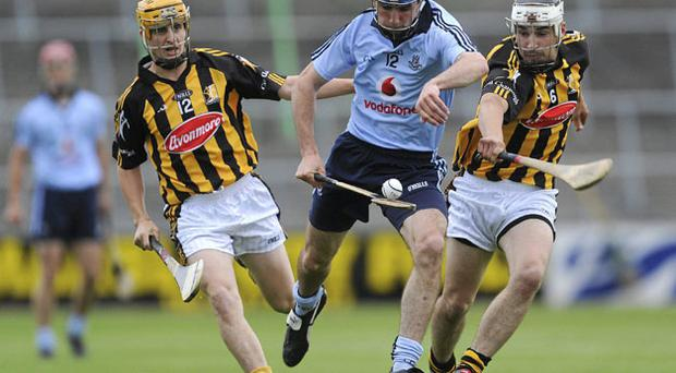 Daire Plunkett tries to get past Liam Ryan (left) and Kieran Mooney during the Bord Gais Energy U-21 Hurling Championship semi-final at Nowlan Park last night. Brian Lawless / Sportsfile