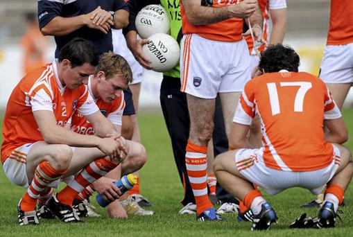 Dejected Armagh players, from left, Andy Mallon, Kieran Toner and Jamie Clarke after the team's defeat to Monaghan in the Ulster Championship. Oliver McVeigh / Sportsfile