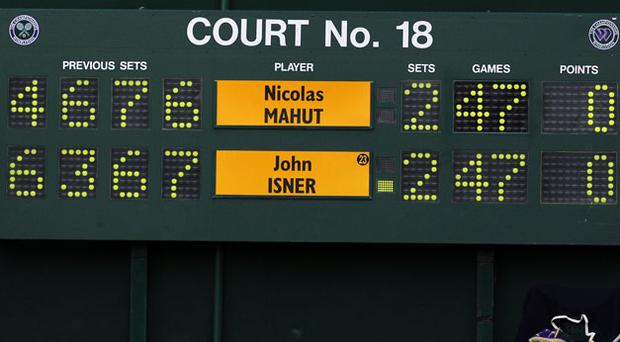The scoreboard shows the last score before it stopped working during the record-breaking marathon match between John Isner and Nicolas Mahut at Wimbledon yesterday. Photo: Getty Images