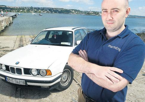 James Beecher with his 2003 BMW Estate, which cost him under €2,000. Picture by Daragh McSweeney