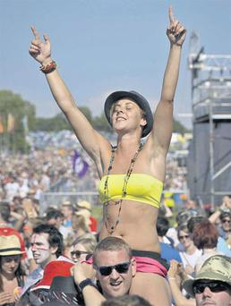 A fan at the 40th annual Glastonbury Festival celebrates England's victory over Slovenia in the World Cup. The crowd watched the match on large screens at the pyramid stage.