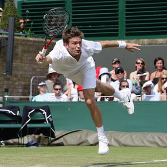 Franc'es Nicolas Mahut in action against US player John Isner in a record breaking game at Wimbledon