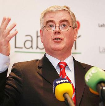 Eamon Gilmore has urged the Government to ensure that banks lend more