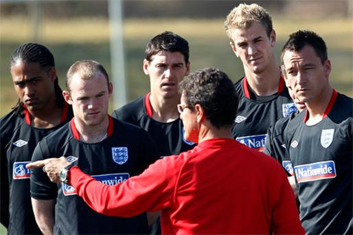 Fabio Capello speaks to England players at training yesterday including Wayne Rooney whose club manager Alex Ferguson insists is fully fit