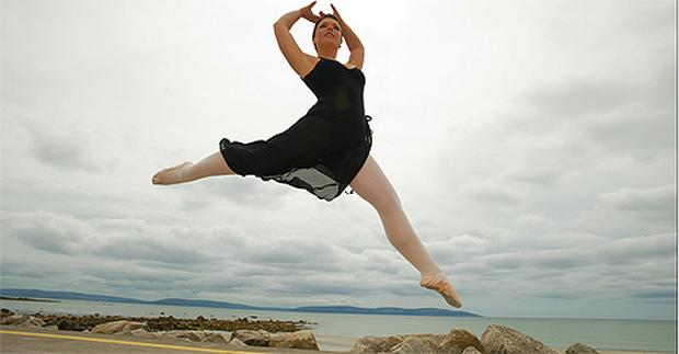 Gillian Quinn jumps for joy on Silver Strand, Galway, yesterday after completing her Leaving Cert music exam