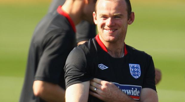Wayne Rooney laughs during an England training session this week. Photo: Getty Images