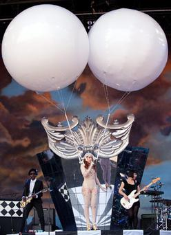 Paloma Faith wears two giant helium-filled balloons while performing on the Pyramid stage.