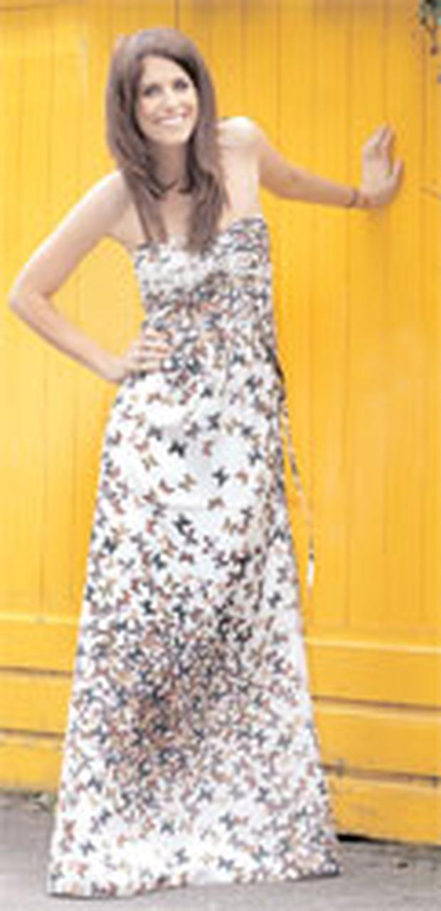 HOLLY WEARS: Butterfly-print, silk maxi, €250, by Ted Baker at House of Fraser, Dundrum Town Centre