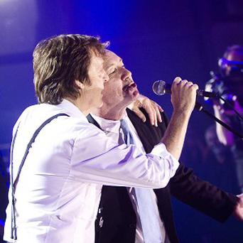 Sir Paul McCartney and Kevin Spacey (right) performing a duet of the Beatles classic Hey Jude