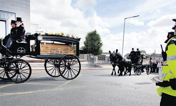Assassination: The Corbally brothers are brought to St Matthew's Church, Ballyfermot, yesterday. Photo: David Conachy