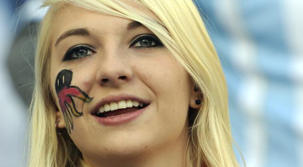 A German supporter cheers prior to the start of the quarter-final football match against Argentina. Photo: Getty Images